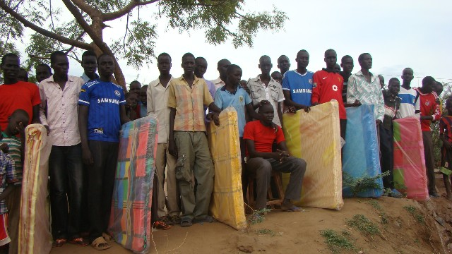 Nuer young men from Sudan with the new Mattresses at Kakuma..jpg